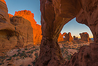 The back side of Double Arch looking through Cove Arch in Arches National Park.