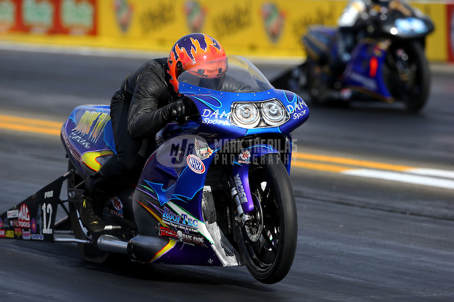 Nov 7, 2013; Pomona, CA, USA; NHRA pro stock motorcycle rider Michael Phillips during qualifying for the Auto Club Finals at Auto Club Raceway at Pomona. Mandatory Credit: Mark J. Rebilas-