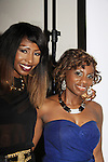 Deliana Dixon (R) Diva Gals Daily poses with Samantha Black at her Fashion Show - NYC Fashion Week - September 7, 2013 - New York City, NY (Photo by Sue Coflin/Max Photos)