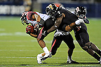 24 September 2011:  FIU safety Jonathan Cyprien (7) tackles ULL wide receiver Javone Lawson (4) in the third quarter as the University of Louisiana-Lafayette Ragin Cajuns defeated the FIU Golden Panthers, 36-31, at FIU Stadium in Miami, Florida.