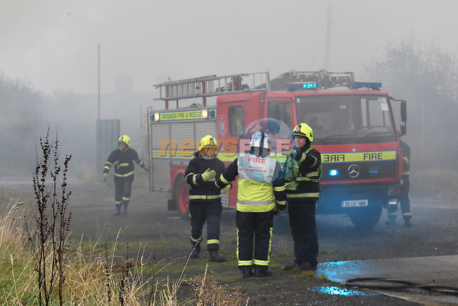 Two fire appliances from Drogheda 14A1, 14A3 backed up by 13A1 and 13J1 from Dunleer attended the scene of a fire in a boarded up Filling station on the Duleek road outside Drogheda on Sunday Evening. The building what was a house was gutted by the fire..Picture: Fran Caffrey/ www.newsfile.ie.