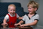 10 month old baby boy happy with brother age 4 horizontal