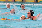 Manhattan Beach, CA 02/16/11 - Marisa Purcell (Mira Costa #17) and Haley Kunert (C)  (Edison #5) in action during the 2011 first round CIF girls waterpolo playoffs between Edison and Mira Costa.