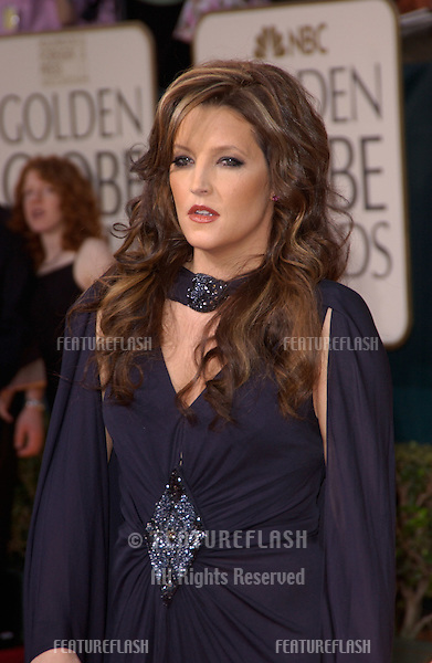 Jan 16, 2005; Beverly Hills, CA: LISA MARIE PRESLEY & date at the 62nd Annual Golden Globe Awards at the Beverly Hilton Hotel..