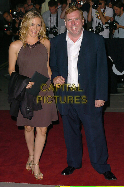 ALICIA SILVERSTONE & TIMOTHY SPALL .The 8th Anual GQ Men of The Year Awards,.The Royal Opera House,.London, 6th September 2005.full length brown bead dress gold strappy sandals black clutch bag purse suit coat arm holding hands.www.capitalpictures.com.sales@capitalpictures.com.©Capital Pictures