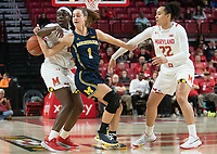 COLLEGE PARK, MD - DECEMBER 28: Ashley Owusu #15 of Maryland and Priscilla Smeenge #2 of Michigan clash. during a game between University of Michigan and University of Maryland at Xfinity Center on December 28, 2019 in College Park, Maryland.