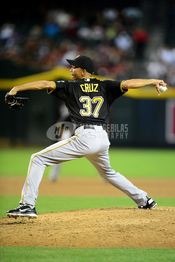 Apr. 17, 2012; Phoenix, AZ, USA; Pittsburgh Pirates pitcher Juan Cruz throws during the game against the Arizona Diamondbacks at Chase Field. The Pirates defeated the Diamondbacks 5-4. Mandatory Credit: Mark J. Rebilas-
