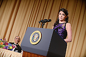 Saturday Night Live's comedian Cecily Strong speaks as President Obama looks on during the annual White House Correspondent's Association Gala at the Washington Hilton hotel April 25, 2015 in Washington, D.C. The dinner is an annual event attended by journalists, politicians and celebrities.<br /> Credit: Olivier Douliery / Pool via CNP