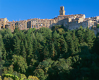 Tuscany, Italy<br /> Village of Pitigliano perched on a rock cliff above the surrounding forest in southern tuscany