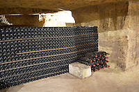 Bottles aging in the cellar. An old quarry. Chateau Clos Fourtet, Saint Emilion, Bordeaux, France