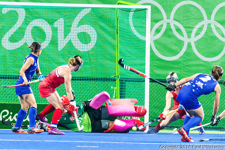 Jackie Briggs #31 of United States saves the penalty corner shot from Nagisa Hayashi #2 of Japan during USA vs Japan in a Pool B game at the Rio 2016 Olympics at the Olympic Hockey Centre in Rio de Janeiro, Brazil.