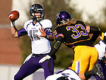 MANKATO, MN - NOVEMBER 1:  Luke Papilion #15 for the University of Sioux Falls looks for a receiver as Tyler Henderson #33 from Minnesota State Mankato applies pressure in the first quarter Saturday afternoon at Blakeslee Stadium in Mankato. (Photo by Dave Eggen/Inertia)