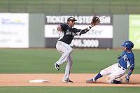 Johmbeyker Morales (9) of the AZL Mariners takes the throw as Ricky Aracena (2) of the AZL Royals slides into second base during a game at Surprise Stadium on July 4, 2015 in Surprise, Arizona. Mariners defeated the Royals, 7-4. (Larry Goren/Four Seam Images)