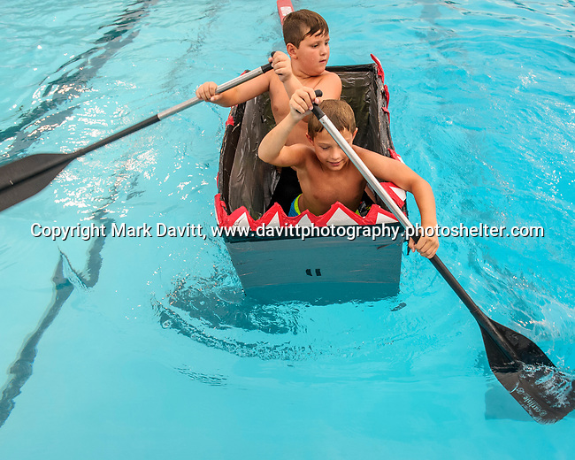 Indianola Park and Recreations hosted cardboard boat races at the Veteran's Memorial Aquatic Center July 22. Auden Auch, front, and Zerik Allen-Cosmio rowed the Shark Attack.