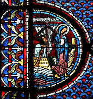 Mary stepping off the boat on arrival in Marseilles, according to the Golden Legend, from the Life of Mary Magdalene stained glass window, 13th century, in the nave of Chartres cathedral, Eure-et-Loir, France. Chartres cathedral was built 1194-1250 and is a fine example of Gothic architecture. Most of its windows date from 1205-40 although a few earlier 12th century examples are also intact. It was declared a UNESCO World Heritage Site in 1979. Picture by Manuel Cohen