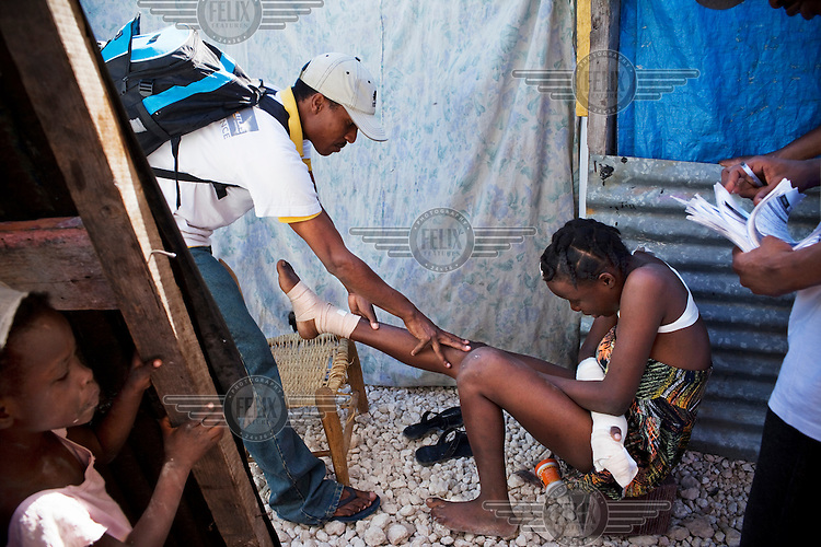 A community worker with the NGO Handicap International visits those living in a camp in Port-au-Prince. A 7.0 magnitude earthquake struck Haiti on 12/01/2010. Early reports indicated that more than 100,000 may have been killed and three million affected.