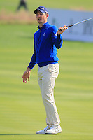 Justin Rose (ENG) takes his putt on the 8th green during Sunday's Final Round of the 2014 BMW Masters held at Lake Malaren, Shanghai, China. 2nd November 2014.<br /> Picture: Eoin Clarke www.golffile.ie
