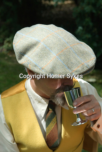 The Chap Olympiad Bedford Square London UK. Man wearing tweed flat cap.