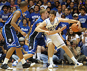 "Ryan Kelly (34) tries to go around the Blue team's defense. Duke men's basketball had an opening scrimmage game as a part of the ""Countdown to Craziness"" event at Cameron Indoor Stadium Friday Oct. 14, 2011.  Photo by Al Drago..."