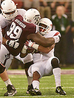 STAFF PHOTO BEN GOFF  @NWABenGoff -- 09/27/14 Texas A&M defensive tackle Ivan Robinson tackles Arkansas running back Jonathan Williams during overtime in the Southwest Classic in AT&T Stadium in Arlington, Texas on Saturday September 27, 2014.
