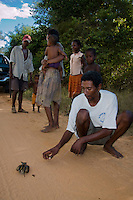 Malagasy people with captive wild bird on a string as a pet