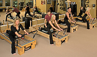 Pilates group session on Reformer apparatus