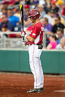 Arkansas Razorbacks outfielder Andrew Benintendi (16) on deck against the Virginia Cavaliers in Game 1 of the NCAA College World Series on June 13, 2015 at TD Ameritrade Park in Omaha, Nebraska. Virginia defeated Arkansas 5-3. (Andrew Woolley/Four Seam Images)