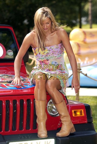KATY HILL.at London Zoo, Regents Park.to launch Nintendo Konga Beach Road Trip.29 July 2004.Ref: PL.sitting flashing underwear knickers.floral print ruffles summery dress cowboy boots, Katie.www.capitalpictures.com.sales@capitalpictures.com.©Capital Pictures.