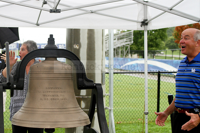 "Vickie Bell rings the ""Wildcat Victory Bell"" and surprise Wendell and herself with how loud the it rang during the dedication ceremony of the Wendell and Vickie Bell Soccer Complex in Lexington, Ky., on Sunday, August 31, 2014. Photo by Jonathan Krueger 