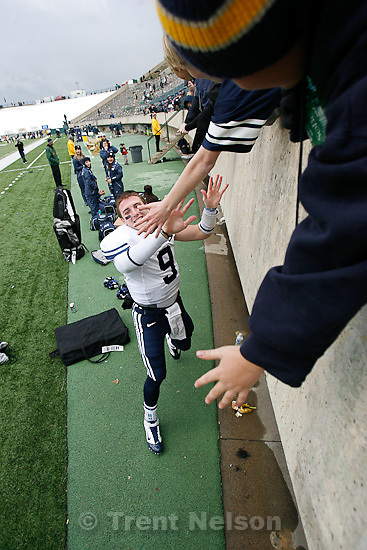 Trent Nelson  |  The Salt Lake Tribune.BYU quarterback Jake Heaps (9) high-fives fans after the win. BYU vs. Colorado State, college football, Saturday, November 13, 2010. BYU won 49-10.