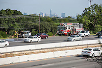 The Austin Fire Department sprays down the engine of a car fire on Texas Loop 1 north MoPac Expressway during afternoon rush hour in Austin, Texas.<br />