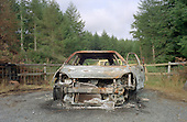 Burnt out car dumped on forestry land above Tan-y-Bwlch, North Wales