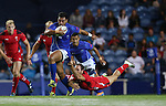 Glasgow 2014 Commonwealth Games<br /> Will Harries dives in to tackle Lio Lolo.<br /> Wales v Samoa<br /> Ibrox Stadium<br /> <br /> 26.07.14<br /> &copy;Steve Pope-SPORTINGWALES