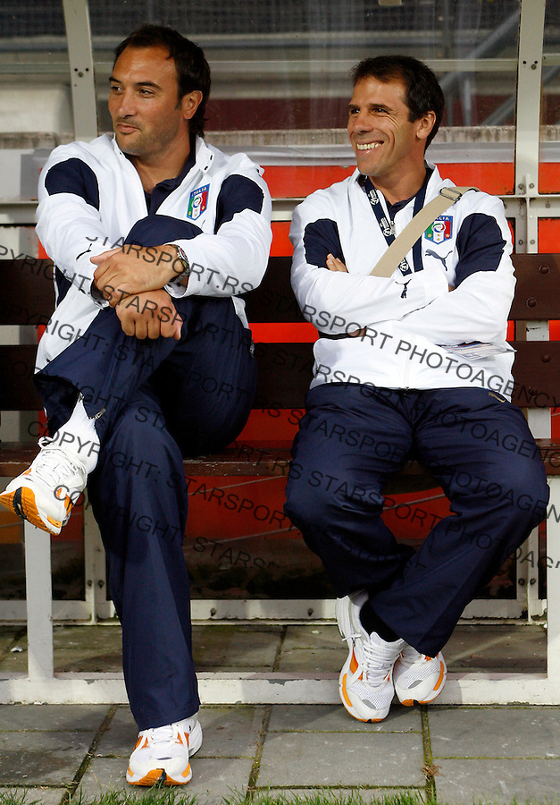 Italy's head coach Pierluigi Casiraghi, left, talk with Gianni Franco Zola, right, during their Olympic 2008 qualifying soccer match at the Goffert stadium in Nijmegen, The Netherlands, Thursday June 21, 2007.