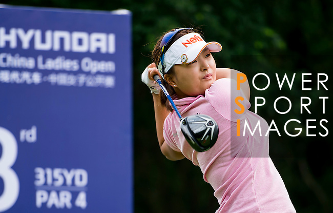 Jin-Young Ko of Korea plays a shot during the Hyundai China Ladies Open 2014 Pro-am on December 10 2014 at Mission Hills Shenzhen, in Shenzhen, China. Photo by Li Man Yuen / Power Sport Images