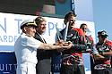 Louis Vuitton Trophy La Maddalena 6 giugno 2010. Un momento della prima e festosa parte della premiazione che si è tenuta sul palco allestito in un piazzale dell'ex arsenale. Dean Barker riceve il trofeo. Alla sua sinistra Yves Carcelle, presidente di Louis Vuitton, e l'Ammiraglio Talarico