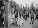 Iraq 1921 .Sheikh Mahmud Barzinji, prisoner of the British army, guarded by Indians troops .Irak 1921 .Sheikh Mahmoud Barzinji, prisonnier des Anglais, sous la surveillance de  soldats indiens