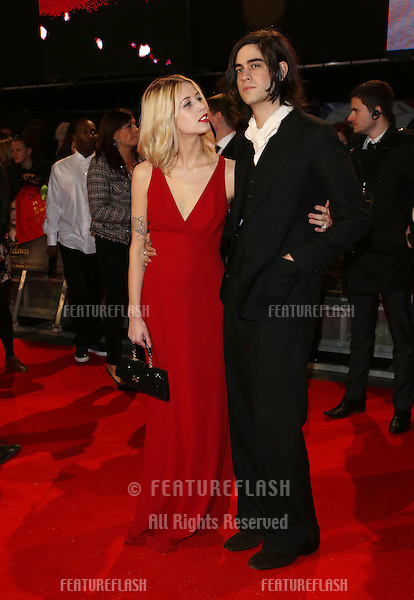 "Peaches Geldof and husband Tom Cohen arriving for the ""The Twilight Saga: Breaking Dawn Part 2"" premiere at the Odeon Leicester Square, London. 14/11/2012 Picture by: Henry Harris / Featureflash"