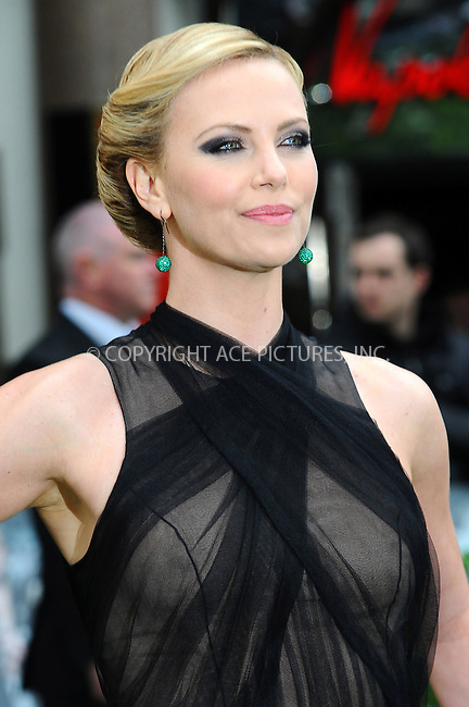 WWW.ACEPIXS.COM . . . . .  ..... . . . . US SALES ONLY . . . . .....May 14 2012, New York City....Charlize Theron at the World premiere of 'Snow White and the Huntsman' on May 14 2012 in London....Please byline: FAMOUS-ACE PICTURES... . . . .  ....Ace Pictures, Inc:  ..Tel: (212) 243-8787..e-mail: info@acepixs.com..web: http://www.acepixs.com
