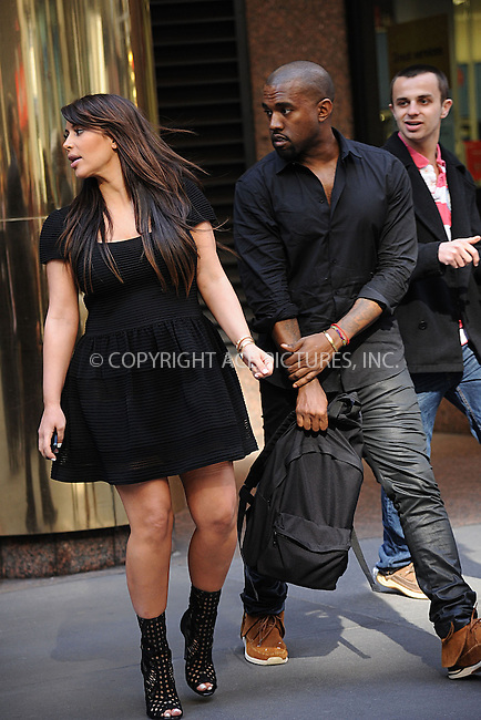 WWW.ACEPIXS.COM......April 24 2013, New York City....Kim Kardashian and Kanye West leave a Midtown office building on April 24 2013 in New York City ......By Line: Kristin Callahan/ACE Pictures......ACE Pictures, Inc...tel: 646 769 0430..Email: info@acepixs.com..www.acepixs.com