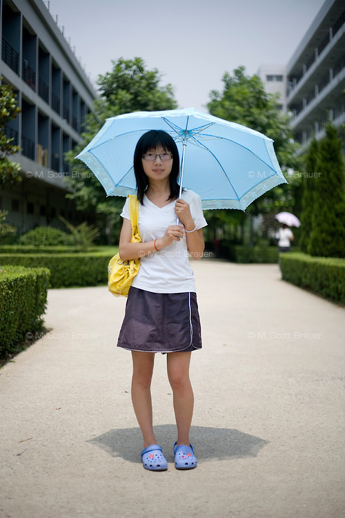 """Ruilingyan, a student, age 21, poses for a portrait in Nanjing. Response to 'What does China mean to you?': 'China is my ancestral country and mother. It's what I hold most dear.'  Response to 'What is your role in China's future?': 'A """"voiceless"""" person has no way of offering society even the smallest contribution.'"""