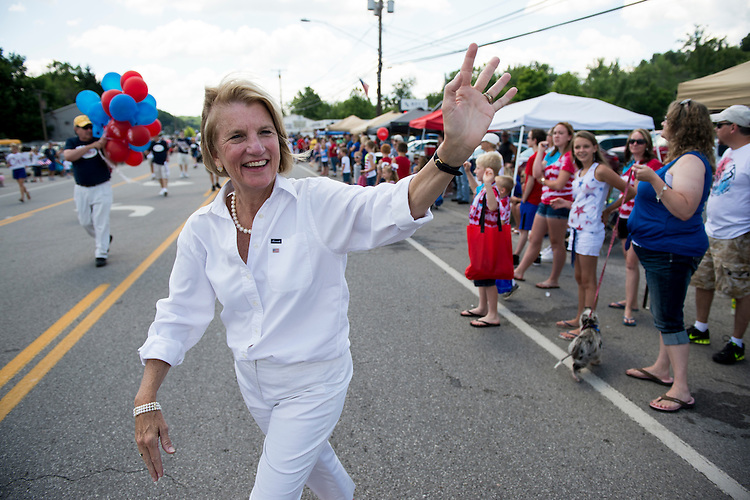 "UNITED STATES - JULY 4: U.S. Senate candidate Rep. Shelley Moore-Capito, R-W.Va., waves to the crowd as she walks in the Ripley 4th of July Parade in Ripley, W. Va., on July 4, 2014. The parade is billed as ""the USA's largest small town Independence Day Celebration. (Photo By Bill Clark/CQ Roll Call)"