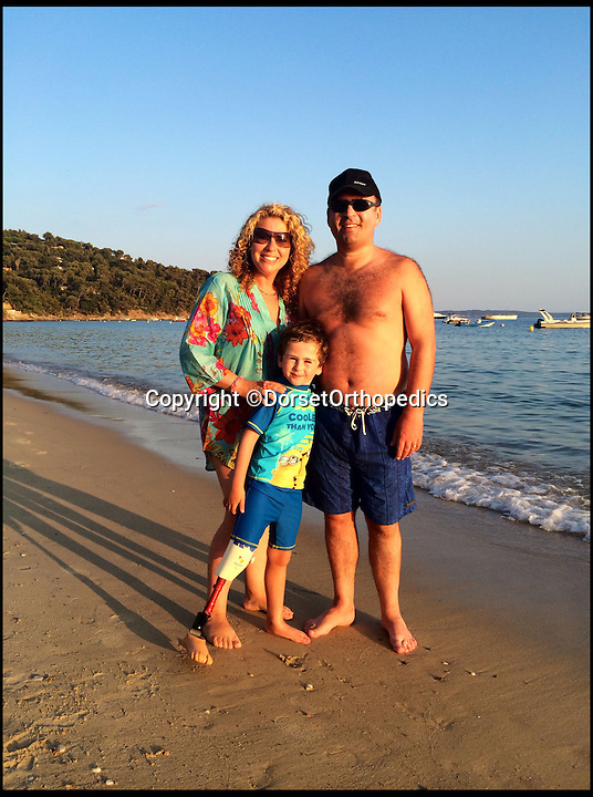 BNPS.co.uk (01202 558833)<br /> Pic: DorsetOrthopedics/BNPS<br /> <br /> ***Please Use Full Byline***<br /> <br /> Rio Woolf with his new leg that allows him to swim. On holiday with parents Juliette and Trevor in France.<br /> <br /> <br /> This is the heartwarming moment a disabled boy was able to swim with a prosthetic leg for the first time.<br /> <br /> Rio Woolf, aged six, had his lower right leg amputated when he was 14-months-old after being born without a tibia, knee, or ankle joint.<br /> <br /> The plucky youngster learnt to walk with NHS limbs and now uses a carbon blade, but has been removing it for swimming.<br /> <br /> He normally take it off in the changing rooms and gets carried to the pool or uses a wheelchair.<br /> <br /> But Rio has now received a state-of-the-art waterproof limb that means he can jump into the water like any other child his age.<br /> <br /> The prosthesis has also improved his lower body balance which has made his back stroke much faster.<br /> <br /> He has also worn it on holiday to France with his mum Juliette and dad Trevor, both 48, and enjoyed going on the beach and in the sea.<br /> <br /> The new leg was created by a leading prosthetics clinic who used an Ossur Junior Vari Flex-Foot with it, so Rio can also wear a shoe.<br /> <br /> It cost around 5,000 pounds and will need to be replaced as Rio grows.