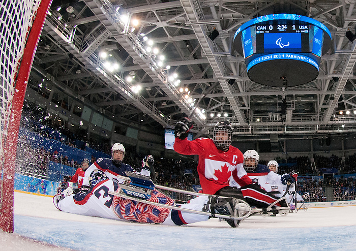Sochi, RUSSIA - Mar 13 2014 - Greg Westlake has a shot stopped by Steve Cash as Canada takes on USA in Sledge Hockey Semi-Final at the 2014 Paralympic Winter Games in Sochi, Russia.  (Photo: Matthew Murnaghan/Canadian Paralympic Committee)