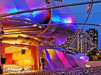 The Pritzker Pavilion in downtown Chicago glows in the color changing lights.