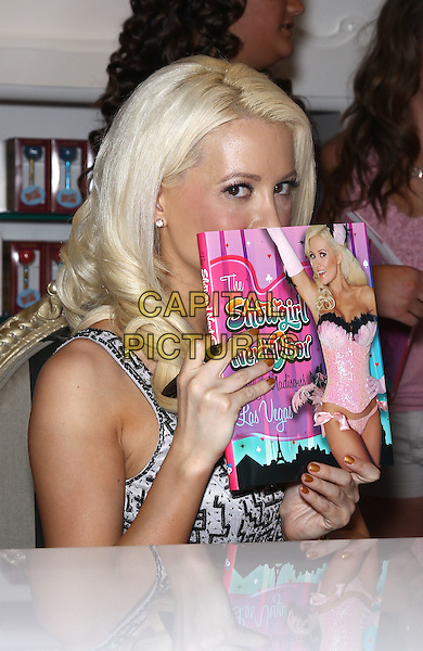 "Holly Madison.Holly Madison hosts a book signing for her new memoir, ""The Show Girl Next Door: Holly Madison's Las Vegas"", at Sugar Factory inside Paris Las Vegas, Las Vegas, Nevada, USA  .11th June 2011.half length dress  white black print   hiding covering face.CAP/ADM/MJT.© MJT/AdMedia/Capital Pictures"