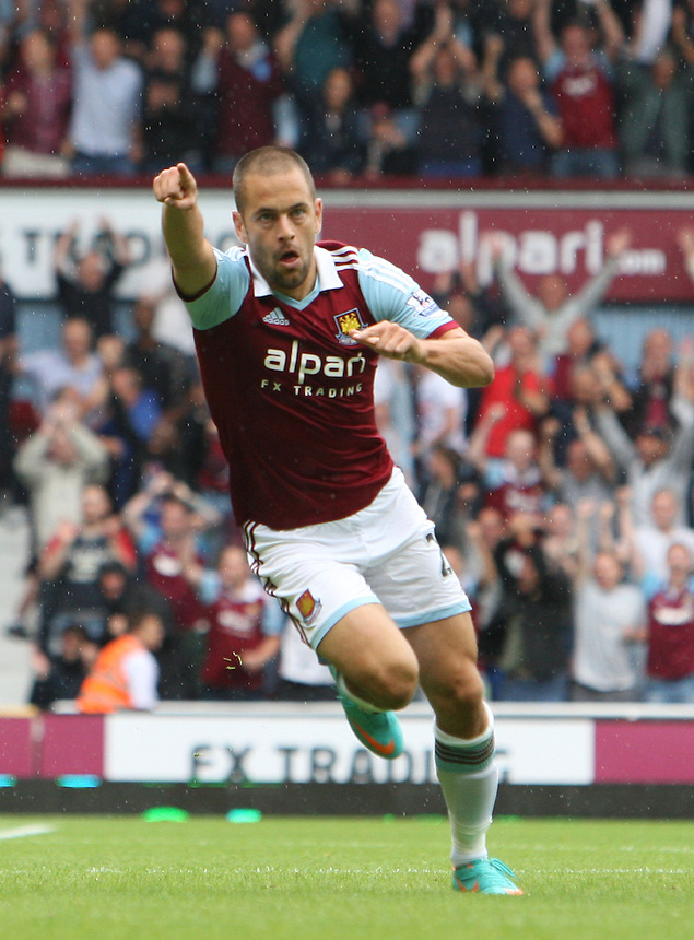 West Ham United's Joe Cole celebrates West Ham opening goal<br />  (Photo by Kieran Galvin/CameraSport) <br /> <br /> Football - Barclays Premiership - West Ham United v Cardiff City - Saturday 17th August 2013 - The Boleyn Ground - London<br /> <br /> &copy; CameraSport - 43 Linden Ave. Countesthorpe. Leicester. England. LE8 5PG - Tel: +44 (0) 116 277 4147 - admin@camerasport.com - www.camerasport.com
