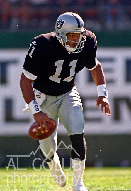 Oakland Raiders vs. Indianapolis Colts at Oakland Alameda County Coliseum Sunday, October  22, 1995.  Raiders beat Colts  30-17.  Oakland Raiders quarterback Vince Evans (11).
