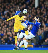 17th March 2019, Goodison Park, Liverpool, England; EPL Premier League Football, Everton versus Chelsea; Ngolo Kante of Chelsea wins the ball in the air from Idrissa Gueye and Andre Gomes of Everton