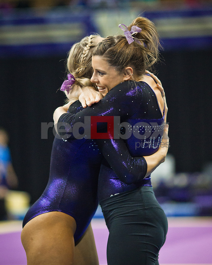 Paige Bixler, Lauren Rogers...Washington Huskies gymnastics vs. the UCLA Bruins at Alaska Airlines Arena at Hec Edmundson Pavilion in Seattle on Friday, January 27, 2012. (Photo by Dan DeLong/Red Box Pictures)